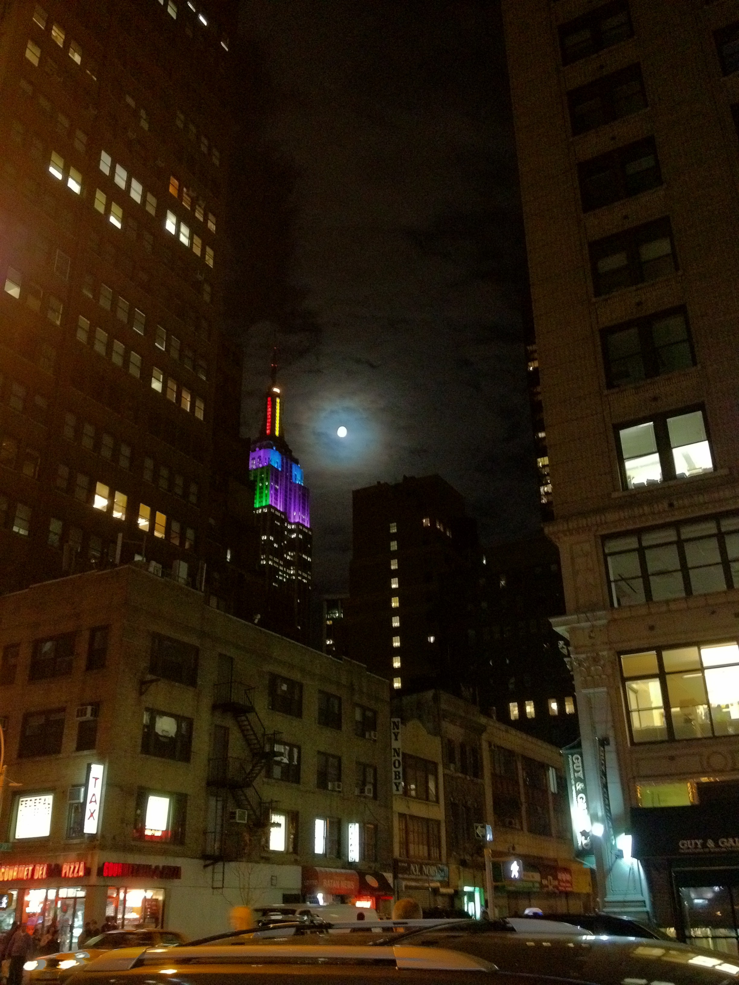 Cool picture of an almost full moon and the Empire State Building